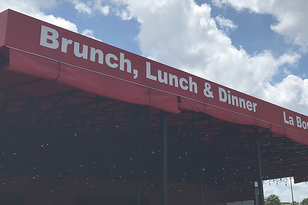 Red commercial awning graphics in Charlotte, NC