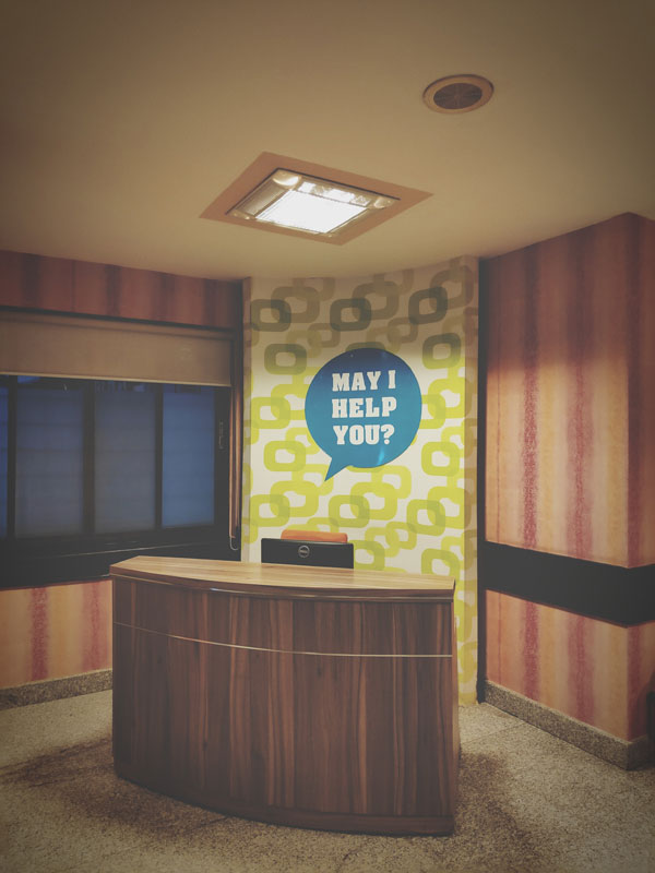Front desk May I Help You signage in Charlotte, NC