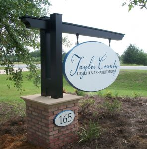 Hanging monument signs with address signs for Taylor County in Charlotte, NC