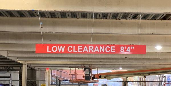 Directional hanging signs by QC Signs Charlotte